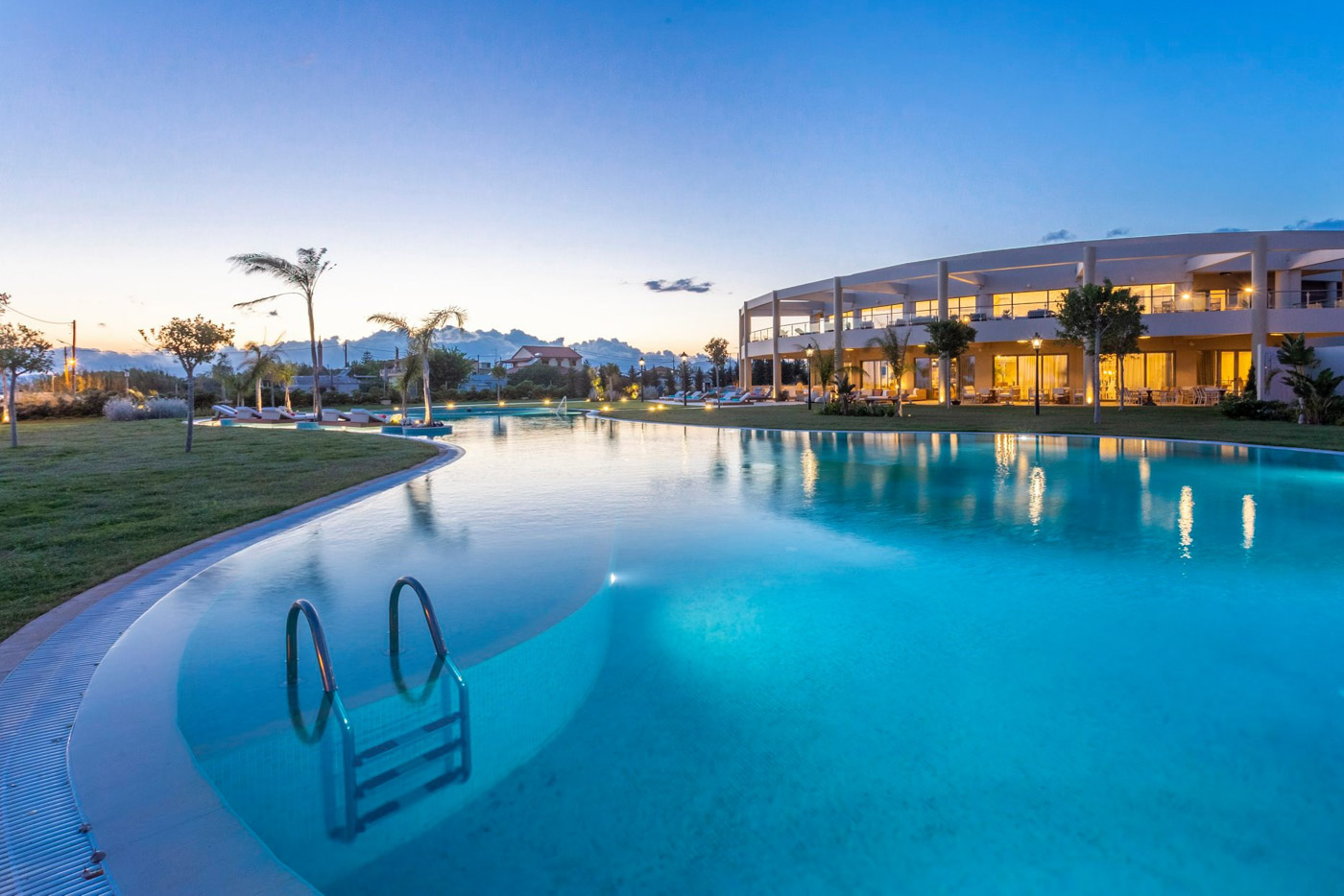 Elysian luxury hotel and spa Kalamata outside pool in blue hour
