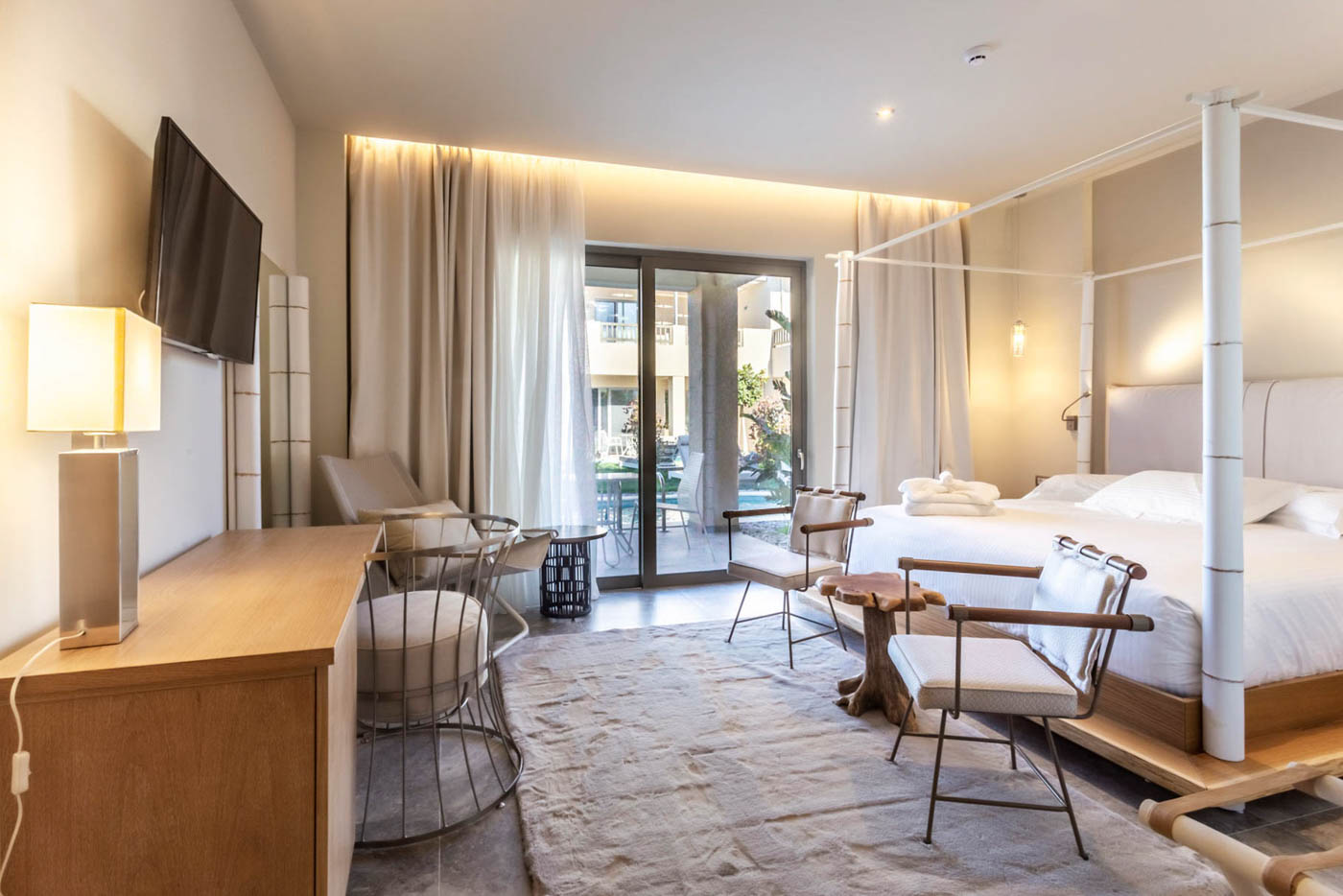 Elysian luxury hotel and spa Kalamata bamboo bedroom and a balcony view