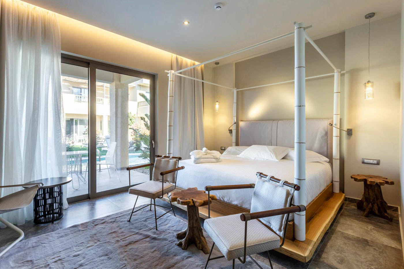 Elysian luxury hotel and spa Kalamata Junior suite bamboo bedroom with two chairs