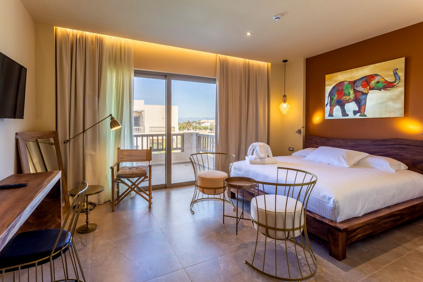 Elysian luxury hotel and spa Kalamata superior room with a balcony door