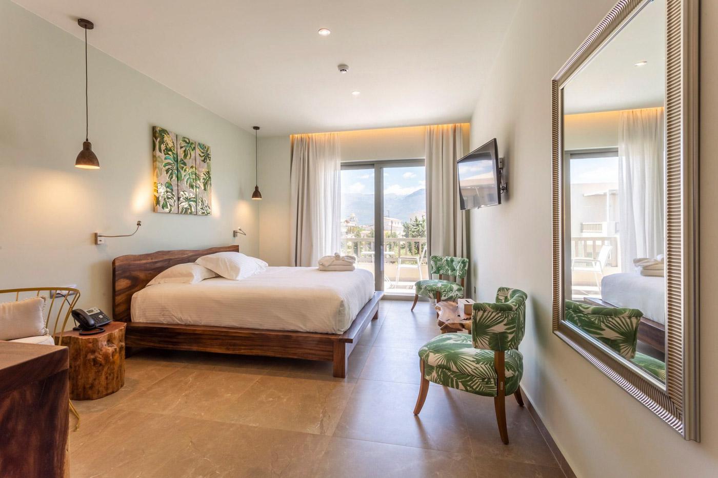 Elysian luxury hotel and spa Kalamata superior room bedroom with balcony