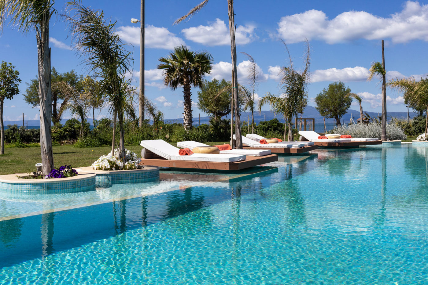 Elysian luxury hotel and spa Kalamata outside pool with lounge area
