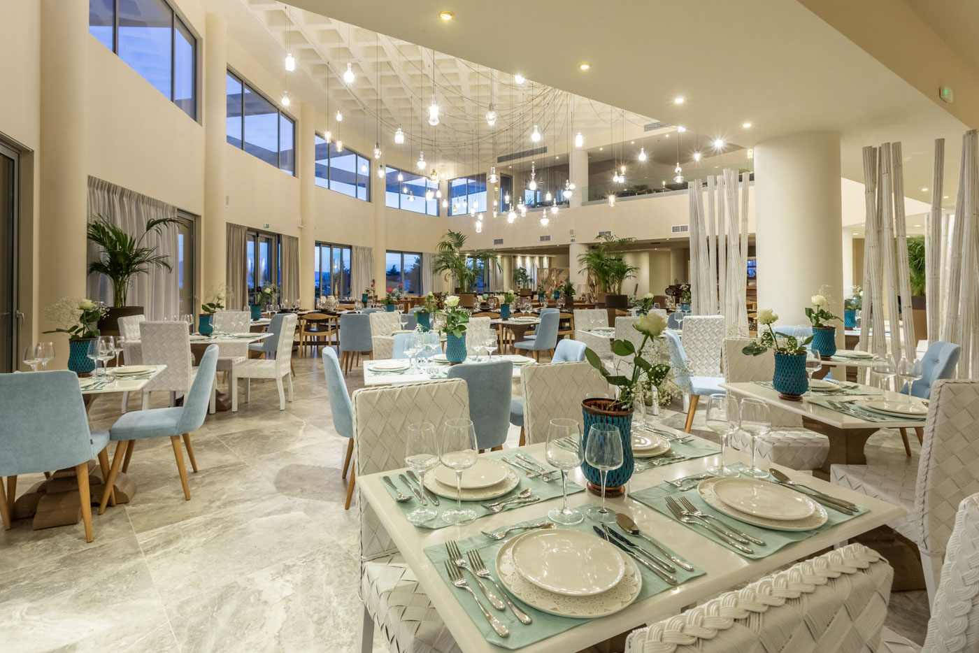 Elysian luxury hotel and spa Kalamata restaurant with decorated tables