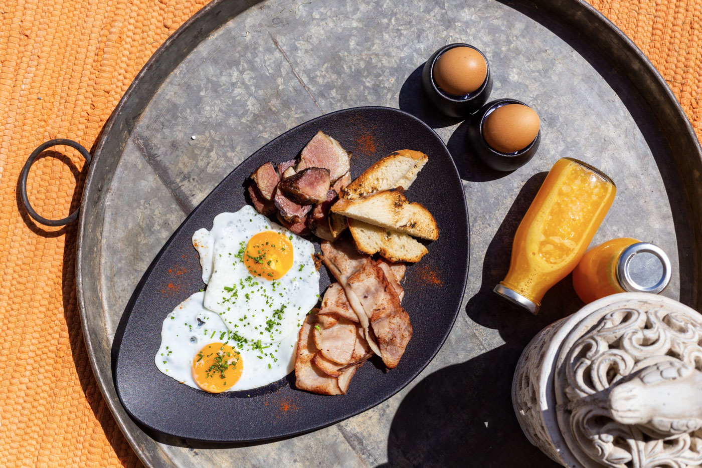 Elysian luxury hotel and spa Kalamata breakfast with fried eggs and bacon